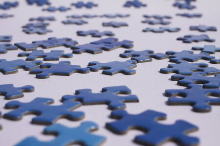 Foto de Close up of isolated blue puzzle pieces, white background - Imagen libre de derechos
