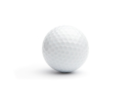 Close up of a golf ball isolared on white