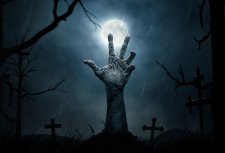 Halloween concept, zombie hand rising out from the soil