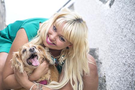 Foto de She is happy hugging her dog. - Imagen libre de derechos