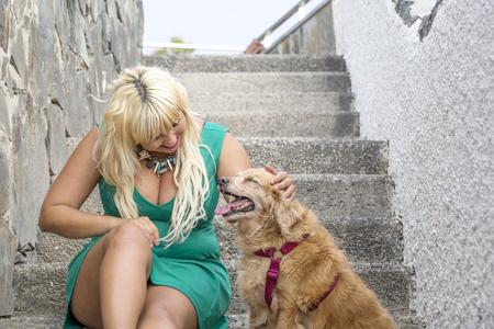 Foto de She caresses her dog - Imagen libre de derechos