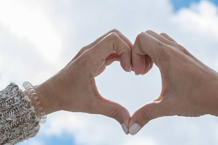 Foto de Hands forming a heart towards the sky. - Imagen libre de derechos