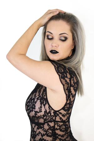 Foto de Isolated sexy woman, with lace lingerie and black makeup - Imagen libre de derechos