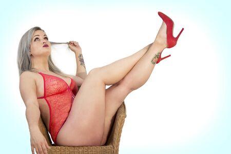 Foto de pin up girl with red lingerie and red heels - Imagen libre de derechos