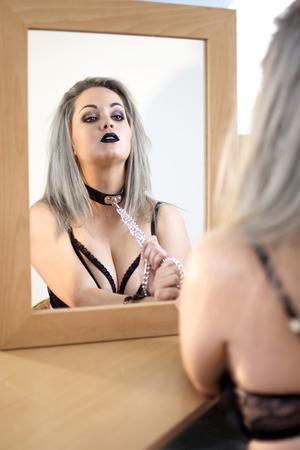 Foto de Reflection of a sexy woman in lingerie with chains - Imagen libre de derechos