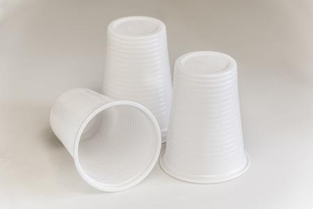 three plastic glasses on a white plain
