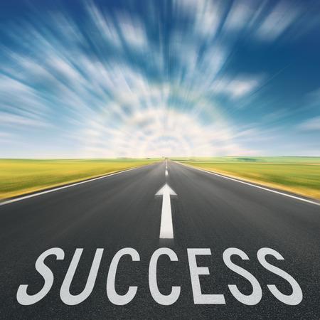 Foto de Driving on an empty asphalt road in blurred motion, towards the light and sign which symbolizing success. Concept for success. - Imagen libre de derechos