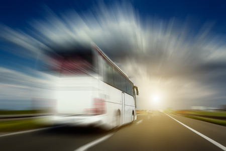 Foto de White bus in blurred motion at full speed performs overtaking on the highway. Photographed from the car when driving. - Imagen libre de derechos