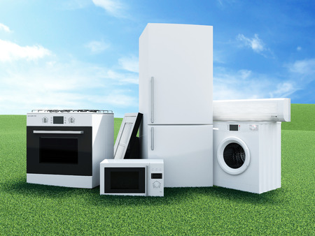 Photo for Group of home appliances on Beautiful Landscape with Clouds and Sun. Refrigerator, Gas cooker, Microwave, Cooker hood, Air conditioner and Washing machine. - Royalty Free Image