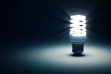 Photo pour Illuminated Fluorescent Light Bulb on blue dark background with place for Your Text - image libre de droit