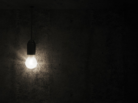 Foto de Hanging Light Bulb in the Empty Concrete Room Interior with place for Your Text - Imagen libre de derechos
