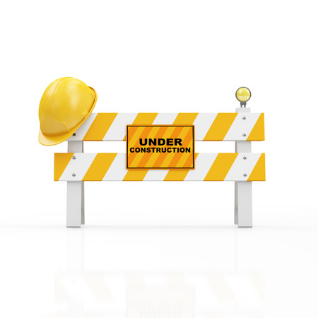 Foto de Under Construction Concept. Yellow Safety Helmet on a Road Barrier isolated on white background - Imagen libre de derechos