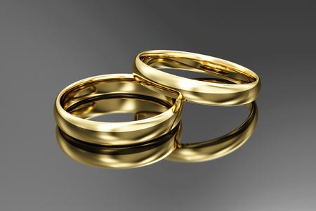 Foto de Golden Wedding Rings on black reflective background. 3D Rendering - Imagen libre de derechos