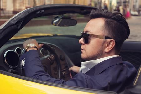 Photo pour Stylish man sitting in sport car - image libre de droit