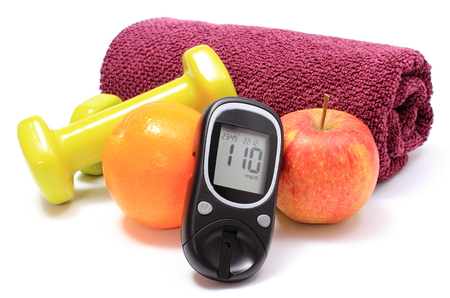 Foto per Glucose meter, fresh fruits, dumbbells and purple towel for using in fitness, concept for diabetes lifestyle and healthy nutrition - Immagine Royalty Free