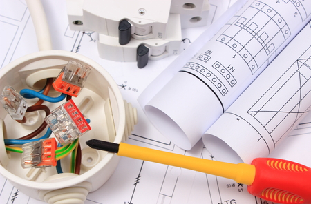 Photo pour Copper wire connections in electrical box, rolls of electrical diagrams and electric fuse on construction drawing of house, accessories for engineering work, energy concept - image libre de droit