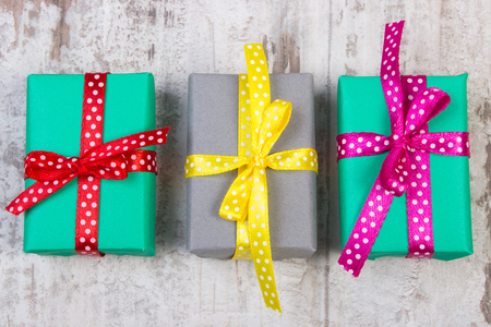 Foto de Wrapped colorful gifts for Christmas, birthday or other celebration on old wooden white plank - Imagen libre de derechos