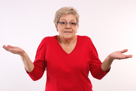 Photo for Elderly senior woman throwing up her hands and shrugging shoulders, human emotions and gesture, having no clue - Royalty Free Image