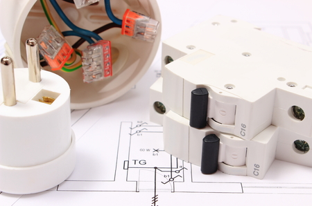 Foto de Electric fuse and plug, copper wire connections in electrical box on construction drawing of house, accessories for engineering work, energy concept - Imagen libre de derechos