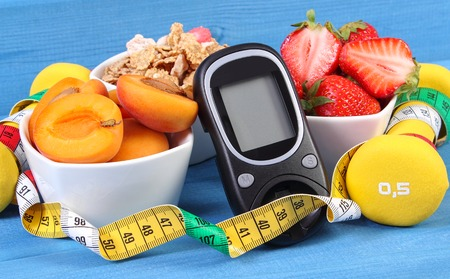 Photo for Glucose meter for measuring sugar level, healthy food, dumbbells for fitness and tape measure, concept of diabetes, slimming and healthy lifestyle - Royalty Free Image