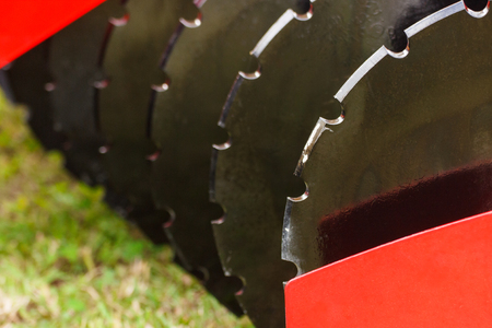 Photo pour Part and detail of agricultural disk harrow, modern technology in agriculture concept - image libre de droit