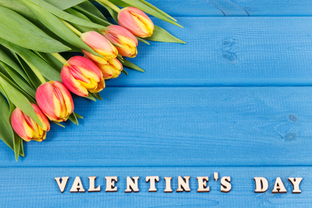 Photo for Bouquet of fresh tulips and inscription Valentines Day on blue boards, place for text - Royalty Free Image
