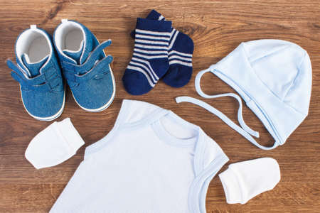 Photo pour Blue clothing for baby boy, expecting for newborn concept - image libre de droit