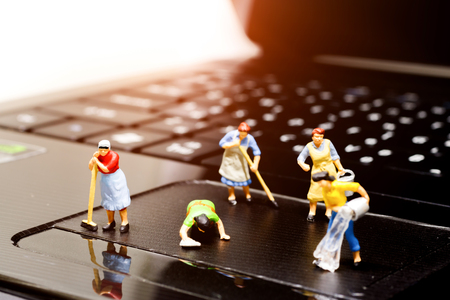 Foto für Miniature women cleaning  pointing device laptop. Concept of cleaning viruses computer, security and technology .  - Lizenzfreies Bild