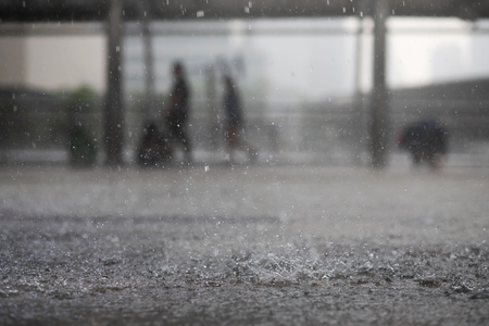Photo pour Rain drops in the water heavy on asphalt shade of black shadow and reflection of dark sky in the city. high contrast during autumn - image libre de droit