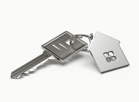Photo pour Mortgage concept. Silver key with house figure isolated on white background - image libre de droit