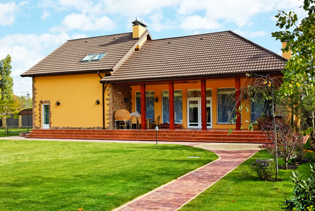 Photo for Exterior of house with green loan - Royalty Free Image