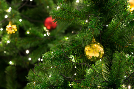 Photo pour Christmas tree with decoration, detail Christmas tree in garden - image libre de droit