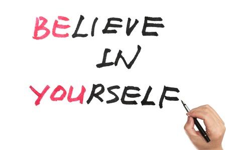 Foto de Be you and believe in yourself words written on white board - Imagen libre de derechos