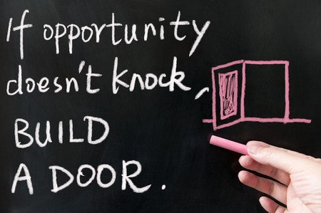 Photo pour If opportunity doesn't knock, build a door words written on blackboard using chalk - image libre de droit