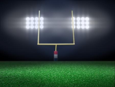 Empty football field with spotlight at night