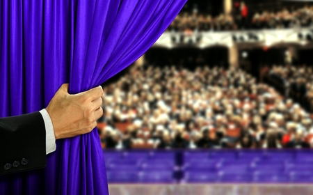 Photo for Hand opening stage curtain and audiance - Royalty Free Image