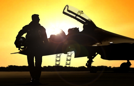 Photo pour Military pilot on airfield walking away from the fighter jet - image libre de droit