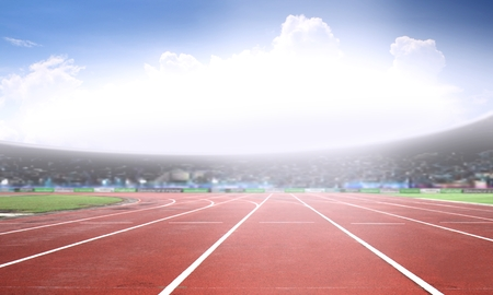 Photo pour Running track in a stadium under bright sunlight - image libre de droit