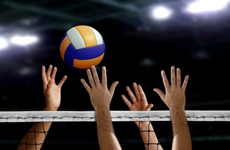 Photo pour Volleyball spike hand block over the net - image libre de droit