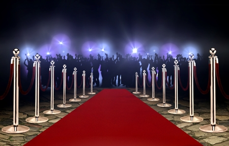 Photo for Red carpet between rope barriers and crowd - Royalty Free Image
