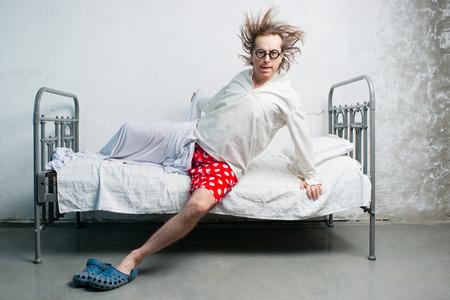 Foto de Funny man gets out of bed - Imagen libre de derechos