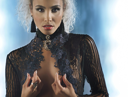 Foto de Portrait of a sexy woman in a black transparent blouse and accessory - Imagen libre de derechos
