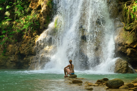 Photo for Tourist swimming in Salto el Limon. Waterfall, Samana, Dominican Republic. - Royalty Free Image
