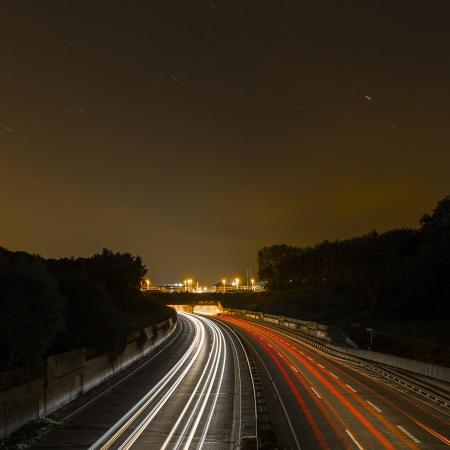 long time exposure freeway cruising car light trails streaks of light speed highway Aix-la-Chapelle