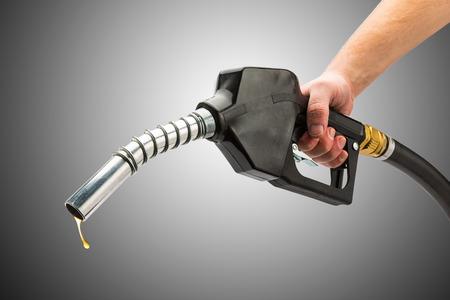 Photo pour holding a gas pump nozzle - image libre de droit