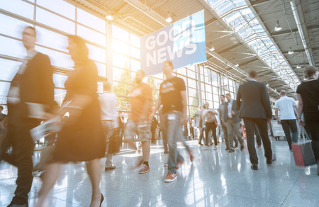 Photo for Blurred business people at a trade show - Royalty Free Image