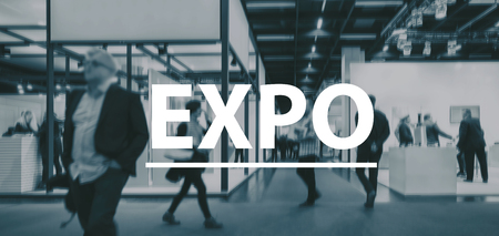 Foto de blurred Business people walking on a Expo - text Concept image - Imagen libre de derechos