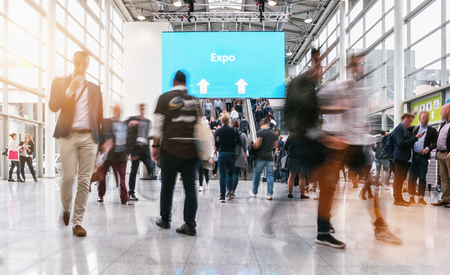 Photo pour anonymous blurred people rushing at a expo - image libre de droit