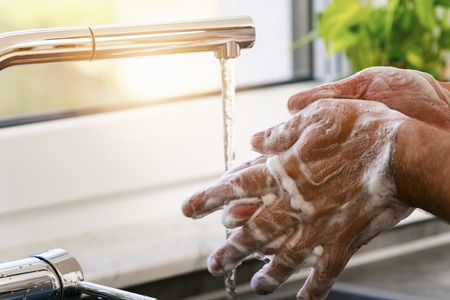 Photo for Man washing hands under water with soap - Royalty Free Image