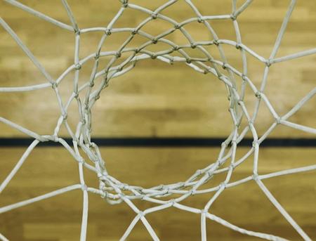 Foto de View from up through  basketball hoop, school sporting wooden board at the bottom  with a black line and kind of reflections. Basketball hoop in the sports hall closeup - Imagen libre de derechos